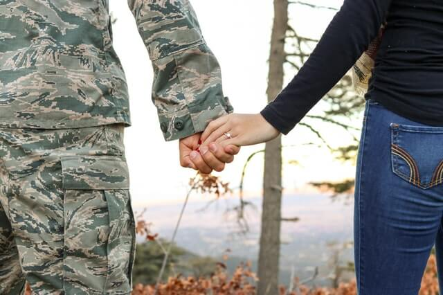 Image of a military couple who just bought a home